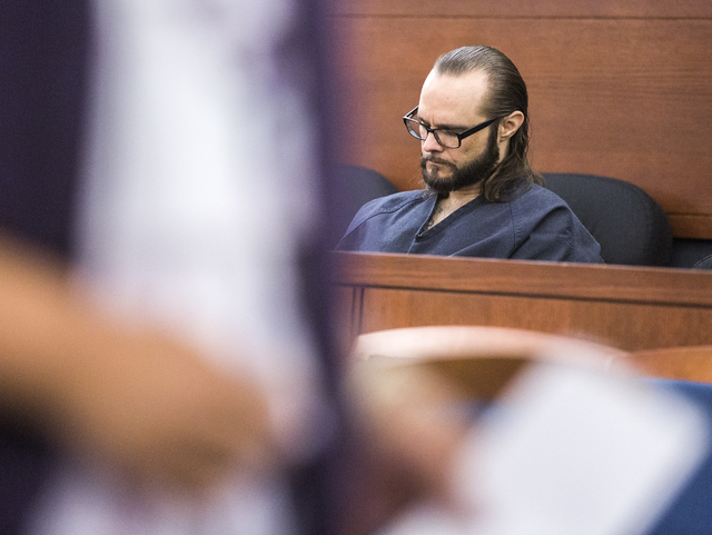 Defendant Sean P. Cordeiro sits while a victim walks past him during his sentencing at Regional Justice Court on Tuesday, Oct. 18, 2016. Cordeiro was sentenced to 96 to 100 years for multiple coun ...