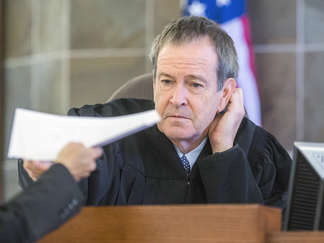 Prosecutor Shanon Clowers hands District Judge Eric Johnson victim statement letters during the sentencing of Sean P. Cordeiro, at Regional Justice Court on Tuesday, Oct. 18, 2016. Cordeiro was se ...