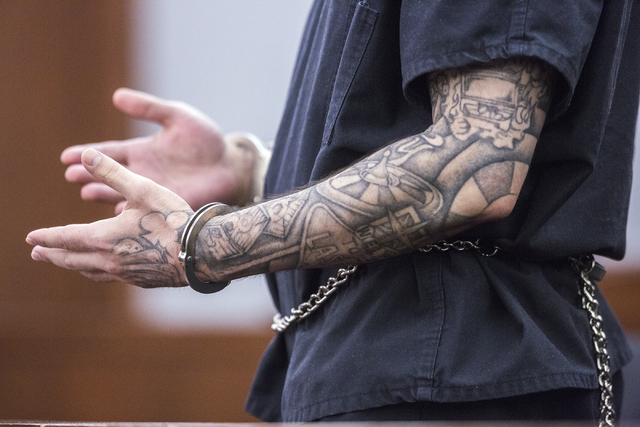 Defendant Sean P. Cordeiro, gestures during his sentencing at Regional Justice Court on Tuesday, Oct. 18, 2016. Cordeiro was sentenced to 96 to 100 years for multiple counts in a 2014 home invasio ...