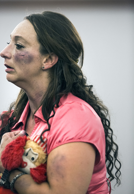 A woman alleged to be Sean P. Cordeiro girlfriend holds a stuffed animal after being kicked out of court by a marshal during Cordeiro's sentencing at Regional Justice Court on Tuesday, Oct. 18, 20 ...