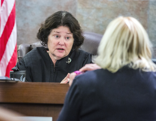 District Judge Elizabeth Gonzalez ,left, talks to defense attorney Lisa Rasmussen during the death penalty trial of defendant Eric Covington at Regional Justice Center on Friday, Oct.14, 2016.  Co ...