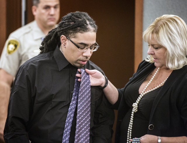 Attorney Lisa Rasmussen, right, holds a tie for defendant Eric Covington during opening statements in the death penalty trial Friday, Oct.14, 2016 at Regional Justice Center.  Covington is  accuse ...