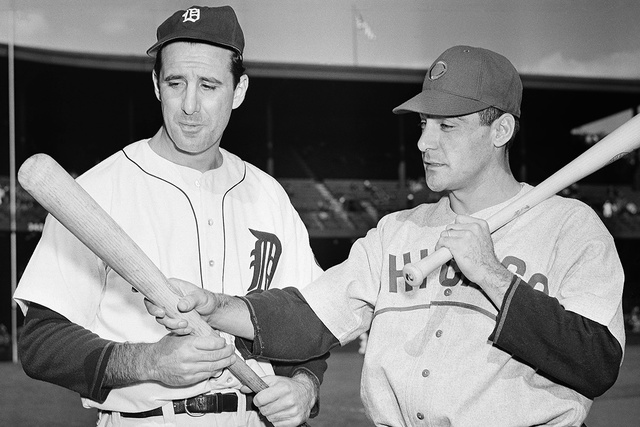 Detroit Tigers left fielder Hank Greenberg, left, and Chicago Cubs first baseman Phil Cavarretta, whose powerful bats were a decisive factor in squaring off the first and second World Series game  ...