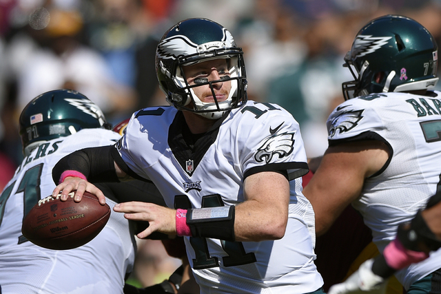 In this Sunday, Oct. 16, 2016, file photo, Philadelphia Eagles quarterback Carson Wentz throws to a receiver in the first half of an NFL football game against the Washington Redskins in Landover,  ...