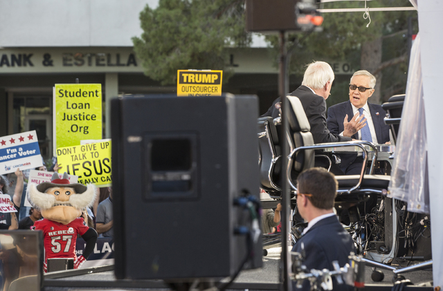 Senate Minority leader Harry Reid, D-Nev., right, is interviewed during a live broadcast of MSNBC outside the Student Union at UNLV on Wednesday, Oct. 19, 2016, in Las Vegas. (Benjamin Hager/Las V ...