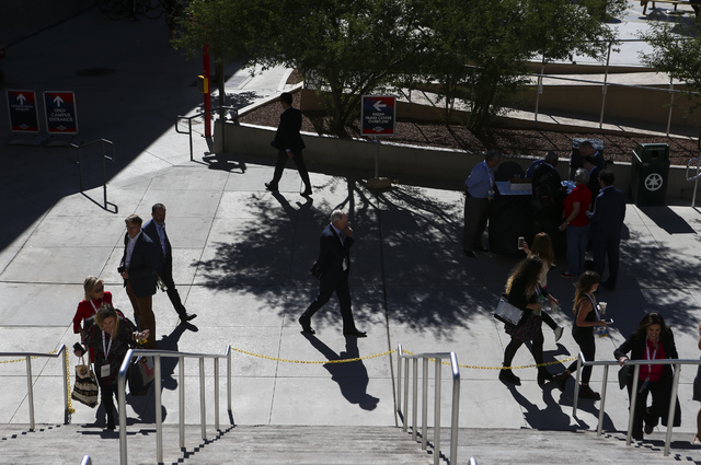 People walk outside of the Thomas & Mack Center ahead of the third presidential debate at UNLV in Las Vegas on Wednesday, Oct. 19, 2016. Chase Stevens/Las Vegas Review-Journal Follow @cssteven ...