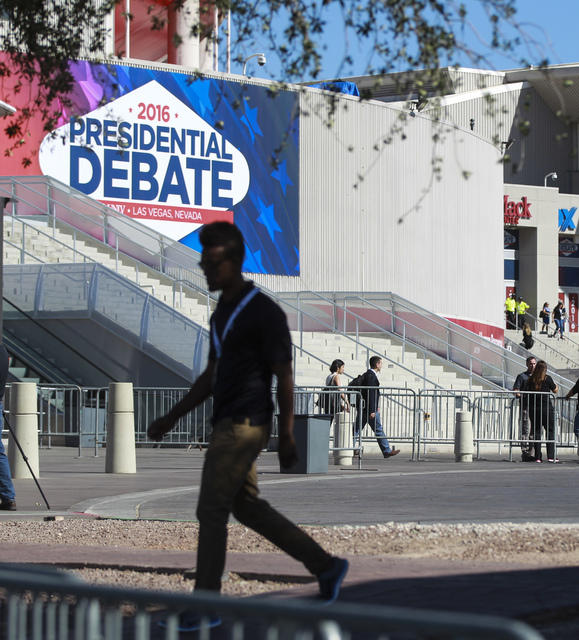 A man walks outside of the Thomas & Mack Center ahead of the third presidential debate at UNLV in Las Vegas on Wednesday, Oct. 19, 2016. Chase Stevens/Las Vegas Review-Journal Follow @cssteven ...