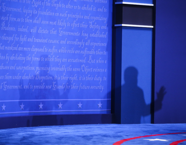 A shadow is cast while Republican presidential candidate Donald Trump speaks during the third presidential debate at the Thomas & Mack Center at UNLV in Las Vegas on Wednesday, Oct. 19, 2016.  ...