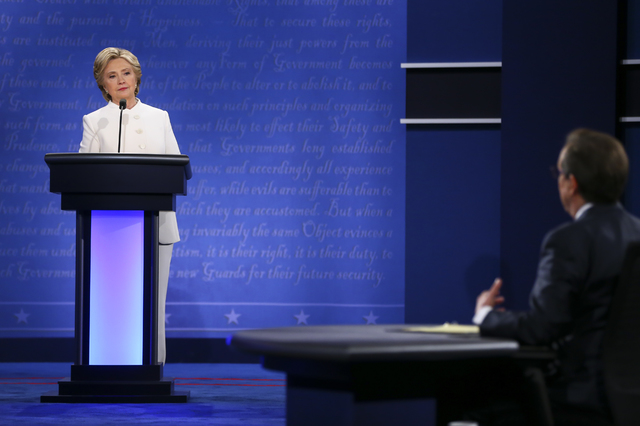 Democratic presidential candidate Hillary Clinton, left, responds to a question from moderator Chris Wallace of Fox News during the third presidential debate at the Thomas & Mack Center at UNL ...