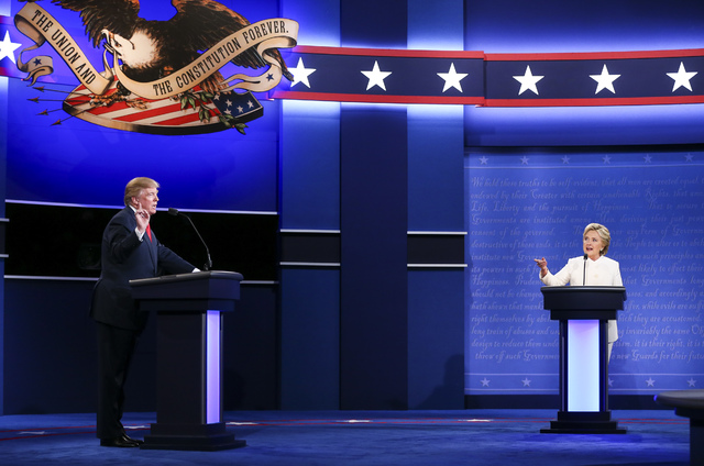 Republican presidential candidate Donald Trump, left, and Democratic presidential candidate Hillary Clinton speak during the third presidential debate at the Thomas & Mack Center at UNLV in La ...