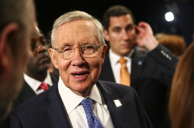Senate Minority Leader Harry Reid makes his way to his seat before the third presidential debate begins at the Thomas & Mack Center at UNLV in Las Vegas on Wednesday, Oct. 19, 2016. Chase Stev ...