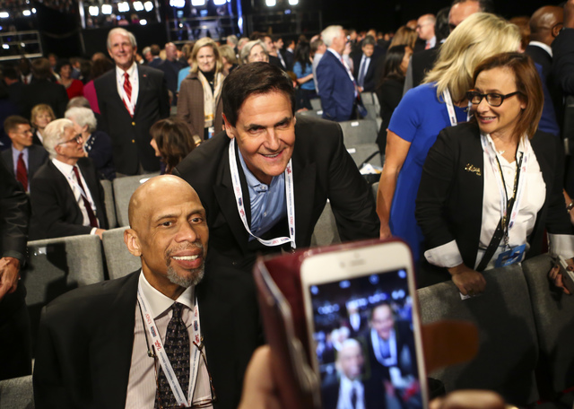Former NBA star Kareem Abdul-Jabbar, left, poses for a photo with businessman Mark Cuban before the third presidential debate begins at the Thomas & Mack Center at UNLV in Las Vegas on Wednesd ...