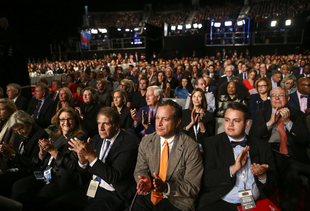 Attendees clap before the third presidential debate begins at the Thomas & Mack Center at UNLV in Las Vegas on Wednesday, Oct. 19, 2016. Chase Stevens/Las Vegas Review-Journal Follow @cssteven ...