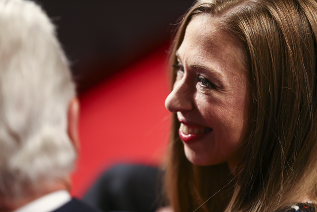 Chelsea Clinton talks to her father, former President Bill Clinton, before the third presidential debate begins at the Thomas & Mack Center at UNLV in Las Vegas on Wednesday, Oct. 19, 2016. Ch ...
