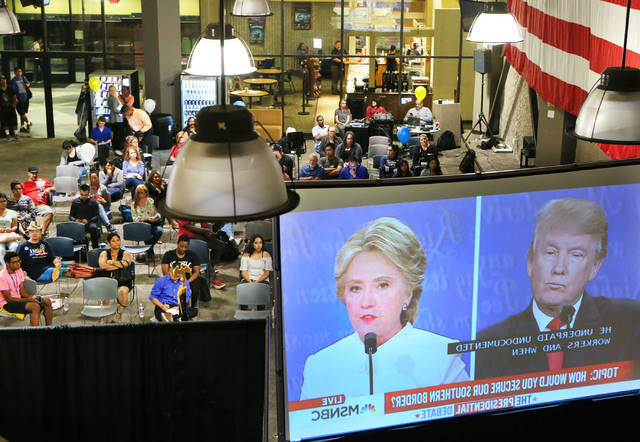 People watch a live broadcast of the third 2016 presidential debate at College of Southern Nevada North Las Vegas campus, Wednesday, Oct. 19, 2016, in North Las Vegas. Ronda Churchill/Las Vegas Re ...