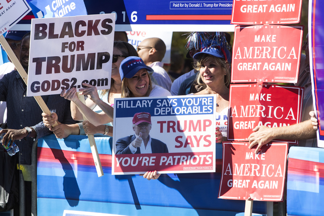 """A woman holds up a """"Blacks for Trump"""" sign at UNLV in Las Vegas on Wednesday, Oct. 19, 2016. Loren Townsley/Las Vegas Review-Journal Follow @lorentownsley"""