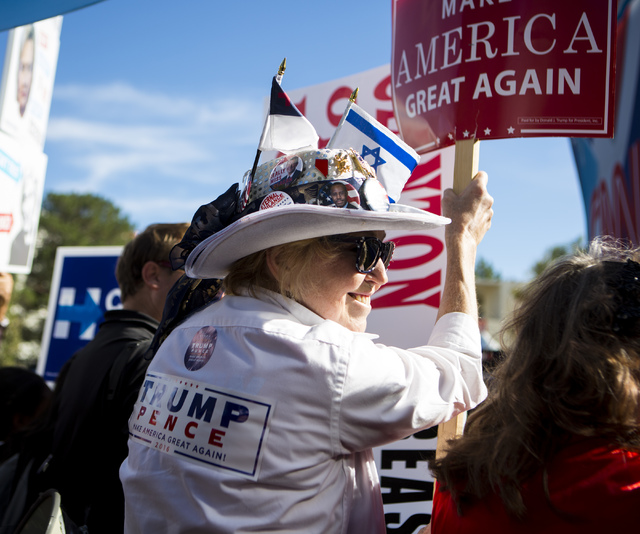 A woman in support of Republican presidential candidate Donald Trump stands in front of the CNN stage ahead of the third presidential debate at UNLV in Las Vegas, on Wednesday, Oct. 19, 2016. Mira ...