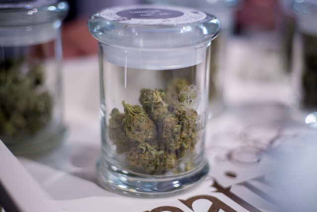 Customers of Native Roots Dispensary look at possible  marijuana bud options to purchase in Denver Colorado Wednesday, Aug. 31, 2016. (Elizabeth Page Brumley/Las Vegas Review-Journal) Follow @ELIP ...