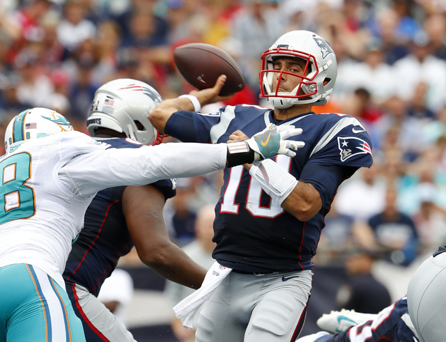 New England Patriots quarterback Jimmy Garoppolo throws under pressure  during a NFL football game against the Miami Dolphins at Gillette Stadium in Foxborough, Mass. Sunday, Sept. 18, 2016. (Wins ...