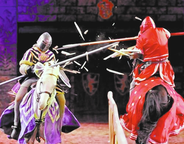 """BILL HUGHES/LAS VEGAS REVIEW-JOURNAL Anthony Root, on Osiris, left, and Chris Warren, on Cubby, demonstrate their jousting skills after the """"Tournament of Kings"""" at the Excalibur."""
