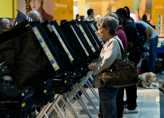 Renee Haga casts her ballot during early voting at the Galleria at Sunset in Henderson on Saturday morning, Oct. 22, 2016. (Daniel Clark/Las Vegas Review-Journal)
