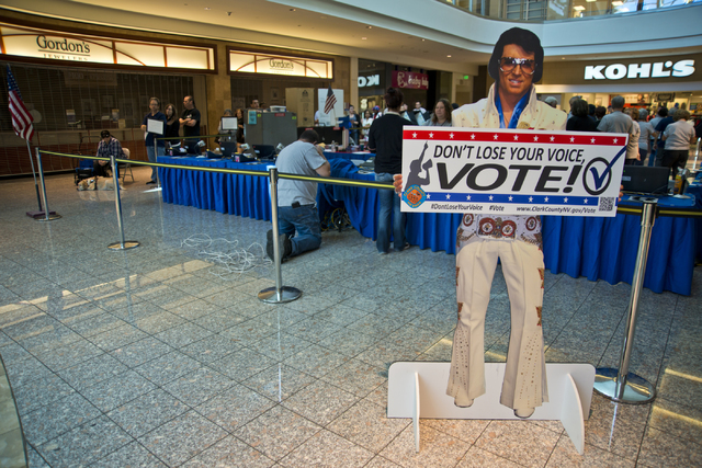 A stand-up Elvis encourages voters to stand in line and be among the first to vote in Nevada at the Galleria at Sunset in Henderson on Saturday morning, Oct. 22, 2016. Daniel Clark/Las Vegas Revie ...