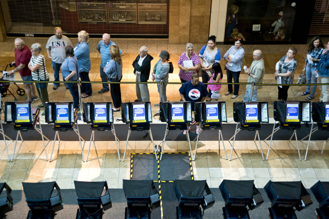 Voters stand in line to be among the first to vote in Nevada during early voting at the Galleria at Sunset in Henderson on Saturday morning, Oct. 22, 2016. Daniel Clark/Las Vegas Review-Journal Fo ...