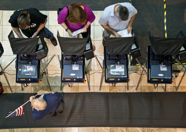 Voters cast ballots during the first day of early voting at the Galleria at Sunset in Henderson on Saturday morning, Oct. 22, 2016. Daniel Clark/Las Vegas Review-Journal Follow @DanJClarkPhoto