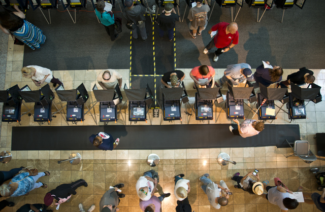 Voters cast ballots and stand in line to be among the first to vote in Nevada at the Galleria at Sunset in Henderson on Saturday morning, Oct. 22, 2016. Daniel Clark/Las Vegas Review-Journal Follo ...