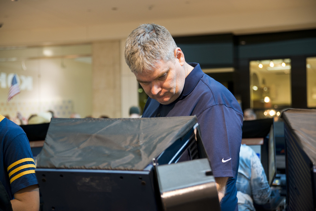 Mike Nahm casts his ballot during early voting at the Galleria at Sunset in Henderson on Saturday morning, Oct. 22, 2016. Daniel Clark/Las Vegas Review-Journal Follow @DanJClarkPhoto
