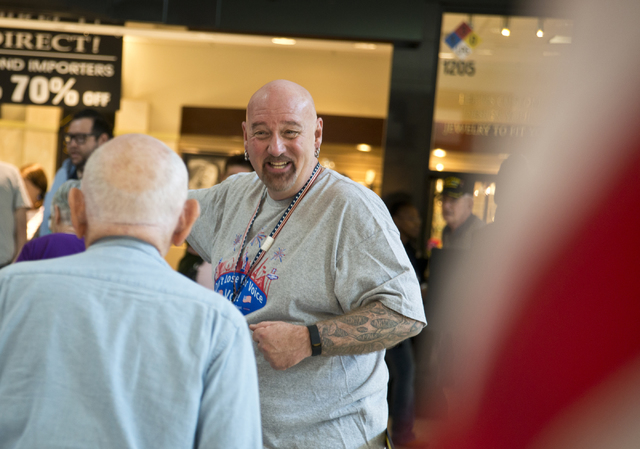 Phillip Hollon directs voters through the check-in process during early voting at the Galleria at Sunset in Henderson on Saturday morning, Oct. 22, 2016. Daniel Clark/Las Vegas Review-Journal Foll ...