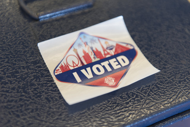 """An """"I Voted"""" sticker sits near the exit of the early voting location at Albertsons at 2885 E. Desert Inn Rd. in Las Vegas, Saturday, Oct. 22, 2016. Jason Ogulnik/Las Vegas Review ..."""