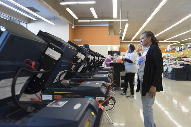 Volunteer Regina Dennis waits to assist voters during early voting at Albertsons at 2885 E. Desert Inn Rd. in Las Vegas, Saturday, Oct. 22, 2016. Jason Ogulnik/Las Vegas Review-Journal