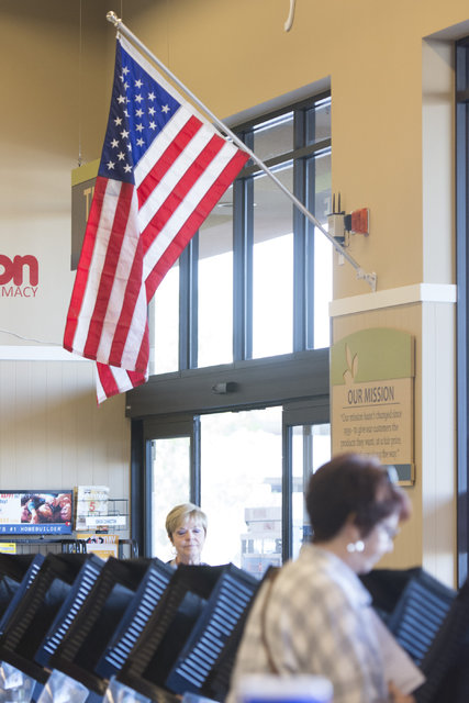 An American flag sits above rows of voting machines during early voting at Albertsons at 2885 E. Desert Inn Rd. in Las Vegas, Saturday, Oct. 22, 2016. Jason Ogulnik/Las Vegas Review-Journal