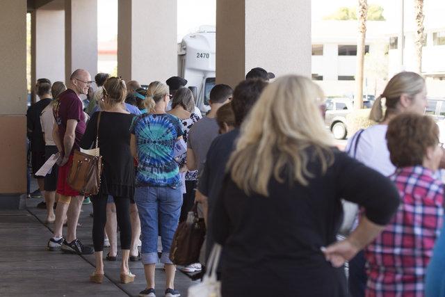 Voters stand in line for early voting at Albertsons at 2885 E. Desert Inn Rd. in Las Vegas, Saturday, Oct. 22, 2016. Jason Ogulnik/Las Vegas Review-Journal