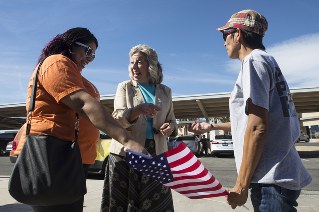Astrid Silva, left, and her mother, Barbara Silva speak with Congresswoman Dina Titus, D-Nev., during an early voting event at the East Las Vegas Community Center in Las Vegas on Saturday, Oct. 22 ...