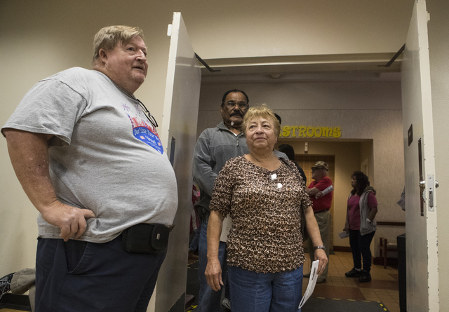 Poll worker Johnny Vaught helps assists voters during early voting at the East Las Vegas Community Center in Las Vegas on Saturday, Oct. 22, 2016. Loren Townsley/Las Vegas Review-Journal Follow @l ...