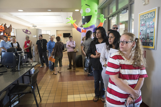 Tifnie Bobbitt, right, and others wait in line during early voting at the East Las Vegas Community Center in Las Vegas on Saturday, Oct. 22, 2016. Loren Townsley/Las Vegas Review-Journal Follow @l ...