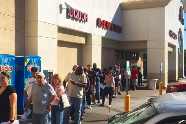 A line of people waiting to vote early outside a Las Vegas CVS on Saturday Oct. 22, 2016. (@DavidsonLVRJ/Twitter)