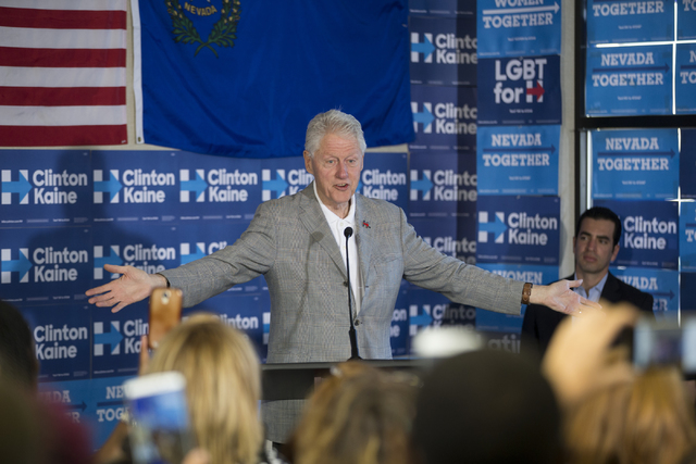 Former President Bill Clinton speaks during an unscheduled stop to a State Democratic Party field coordinated office canvass kickoff event on Thursday, Oct. 20, 2016, in North Las Vegas. (Erik Ver ...