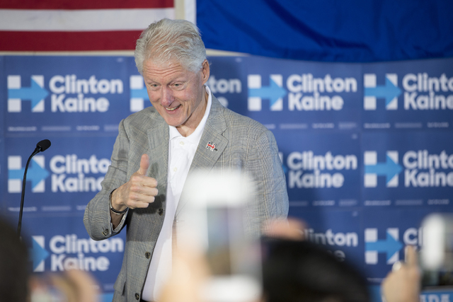 Former President Bill Clinton gestures at supporters during an unscheduled stop to a State Democratic Party field coordinated office canvass kickoff event on Thursday, Oct. 20, 2016, in North Las  ...