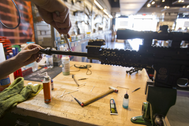 A gunsmith prepare a rifle for a customer at Westside Armory, a gun and ammo store, located at 7345 S. Durango Drive in Las Vegas on Tuesday, Oct. 18, 2016. Richard Brian/Las Vegas Review-Journal  ...