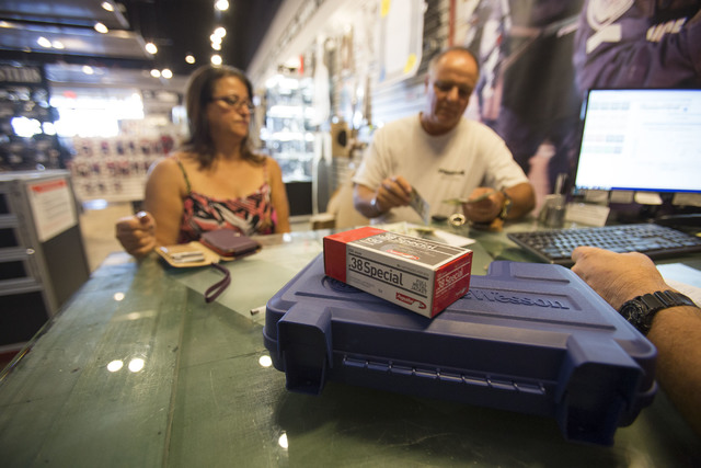 Boulder City residents Fatina Kamou, left, and her fianc Dan Laza purchasing a handgun at Westside Armory, a gun and ammo store, located at 7345 S. Durango Drive in Las Vegas on Tuesday, Oct. 18,  ...