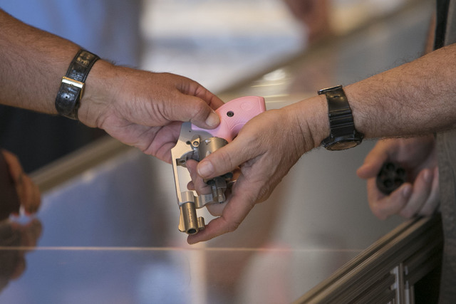 A customer tries out a handgun at Westside Armory, a gun and ammo store, located at 7345 S. Durango Drive in Las Vegas on Tuesday, Oct. 18, 2016. Richard Brian/Las Vegas Review-Journal Follow @veg ...