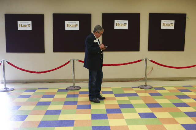 Former Nevada Gov. Bob List checks his phone before a rally for U.S. Rep. Cresent Hardy, R-Nev., at Pearson Community Center in North Las Vegas on Saturday, Oct. 29, 2016. Chase Stevens/Las Vegas  ...