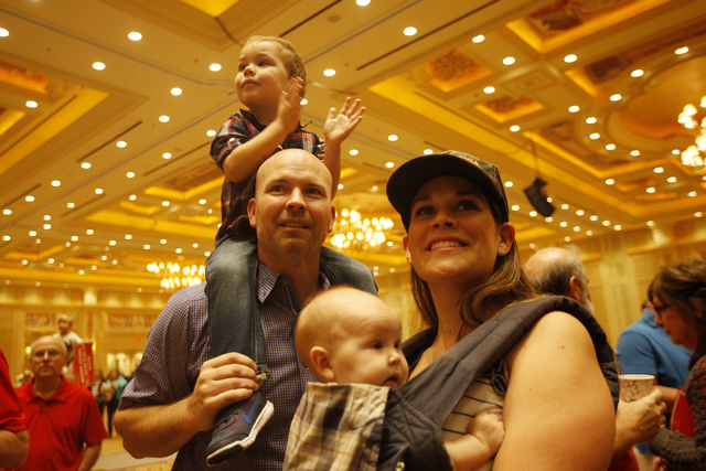 Will Koby, from left, with his son George, 3, on his shoulders stands by his wife Mandy Koby and their daughter Lucy, 5 months, as they wait for the Trump rally to start on Sunday, Oct. 30, 2016,  ...