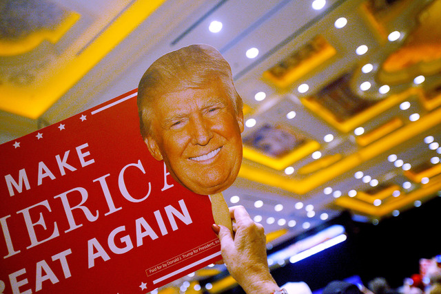 An attendee at the Trump rally holds up a sign of Republican presidential candidate Donald Trump's face on Sunday, Oct. 30, 2016, at the Venetian in Las Vegas. Rachel Aston/Las Vegas Review Journa ...