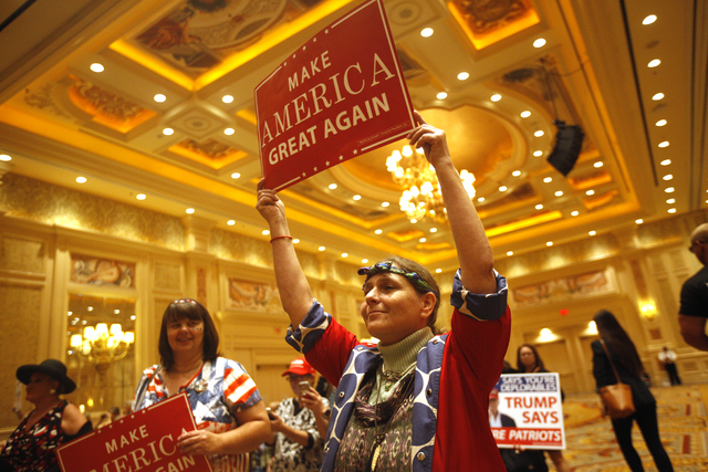 Paula Edwards waves a sign at a Trump rally on Sunday, Oct. 30, 2016, at the Venetian in Las Vegas. Rachel Aston/Las Vegas Review Journal Follow @rookie__rae