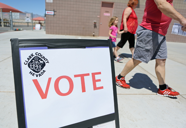 People leave after voting in the primary election at Robert L. Forbuss Elementary School Tuesday, June 14, 2016, in Las Vegas. (Ronda Churchill/Las Vegas Review-Journal)