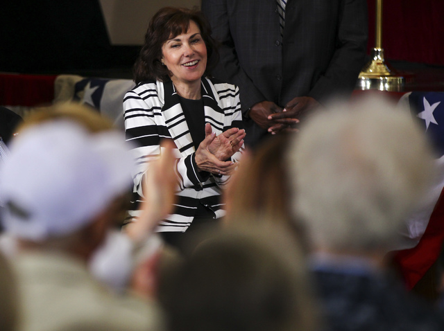 Jacky Rosen, Democratic nominee for the 3rd Congressional District, claps as Democratic vice presidential candidate Sen. Tim Kaine, D-Va., speaks during a campaign event at Sun City MacDonald Ranc ...